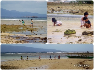 Some locals collecting shells and some kids playing on the beach.