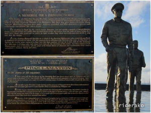"""The plaque of """"A Memorial of Fulfilled Promise"""" by Ferdinand Marcos and the plaque of  """"Proclamation"""" by Gen. McArthur."""