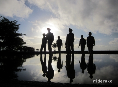 the silhouettes of Gen. McArthur, President Sergio Osmeña, General Carlos P. Romulo, General Sutherland and other men in the Landing Memorial Park during sunrise.