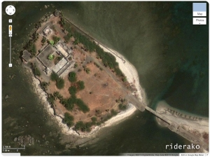 The satellite view shows something like a bridge leading to the island. There is also at least one building on it.